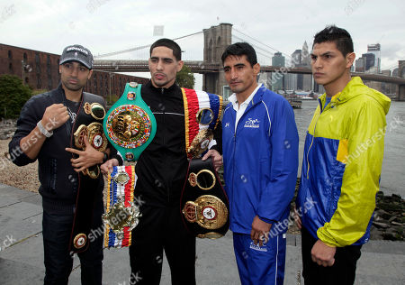 Danny Garcia, Erik Morales, Paul Malignaggi, Pablo Cesar Cano Boxer Danny Garcia, second left, from Philadelphia, the current Ring Magazine, WBC and WBA Super Lightweight Champion, wears his belts, as he poses for photos with opponent Erik Morales, of Tijuana, Mexico, third left, near the Brooklyn Bridge, in the Brooklyn borough of New York, . Paul Malignaggi, left, of Brooklyn, N.Y., the current WBA Welterweight Champion, and opponent Pablo Cesar Cano, right, will face each other on the undercard at the Barclays Center, in the Brooklyn borough of New York, Saturday night