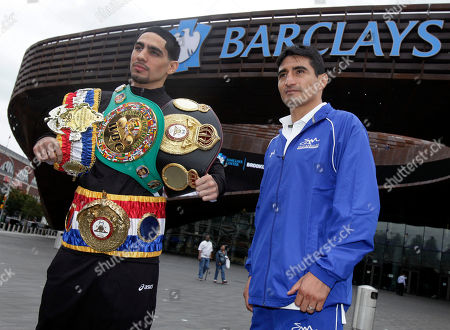 Danny Garcia, Erik Morales Boxer Danny Garcia, left, from Philadelphia, the current Ring Magazine, WBC and WBA Super Lightweight Champion, wears his belts, as he poses with opponent Erik Morales outside the Barclays Center, in the Brooklyn borough of New York, . Garcia is scheduled to defend his titles against Morales, of Tiajuana, Mexico, Saturday night at the venue