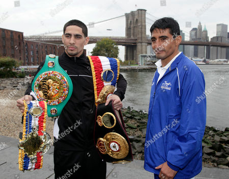 Danny Garcia, Erik Morales Boxer Danny Garcia, left, from Philadelphia, the current Ring Magazine, WBC and WBA Super Lightweight Champion, wears his belts, as he poses for photos with opponent Erik Morales near the Brooklyn Bridge, in the Brooklyn borough of New York, . Garcia is scheduled to defend his titles against Morales, of Tijuana, Mexico, Saturday night at the Braclays Center in Brooklyn