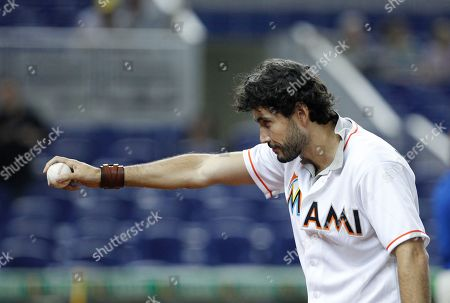 Khotan Fernandez Mexican actor Khotan Fernandez prepares to out a ceremonial first pitch before a baseball game between the Miami Marlins and the Atlanta Braves, in Miami