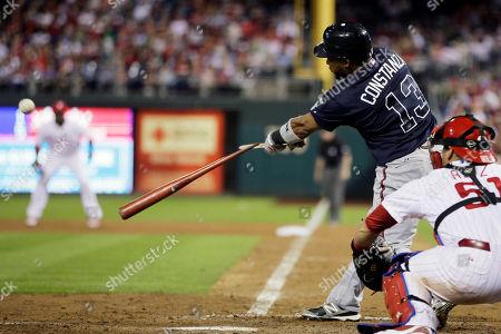 Carlos Ruiz, Jose Constanza Atlanta Braves' Jose Constanza (13) breaks his bat on a RBI-single in the seventh inning of a baseball game against the Philadelphia Phillies, in Philadelphia. Philadelphia's catcher Carlos Ruiz is at right. Philadelphia won 6-2