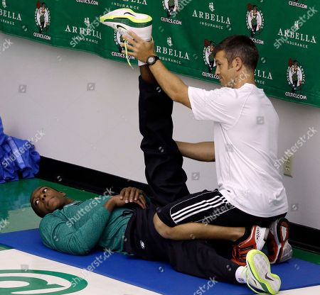 Rajon Rondo Boston Celtics' Rajon Rondo is stretched by a trainer during the team's final basketball practice in Waltham, Mass., before leaving for exhibition games in Turkey and Europe