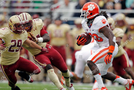 Kevin Pierre-Louis, James McCaffrey, Andre Ellington Clemson running back Andre Ellington, right, carries the ball as Boston College defensive back James McCaffrey (29) and linebacker Kevin Pierre-Louis (24) defend in the first quarter of an NCAA college football game in Boston