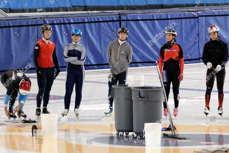 Utah Olympic Oval FAST Team members huddle on the track during practice for the U.S. Single Distance Short Track Speedskating Championships, in Kearns, Utah. Fourteen current members of the national team, including 2010 Olympic medalists Allison Baver, J.R. Celski, Travis Jayner and Jordan Malone, initially signed a grievance alleging they were abused verbally, physically and psychologically by head coach Jae Su Chun