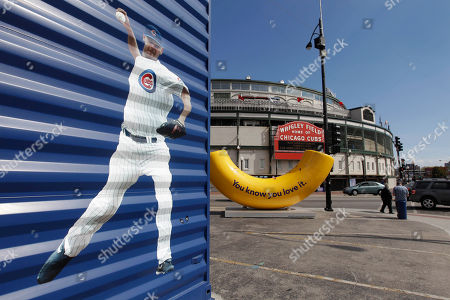 An image of Chicago Cubs pitcher Kerry Wood adorns the side of a building across the street from Wrigley Field, in Chicago. Even for a team with a record of futility unmatched in professional baseball and, heck, all of professional sports, this season has been one of the most dismal in Cubs history. About the only good thing that could be said about a team poised to lose 100 games for the first time in 46 years--one of which came after the shortstop trotted off the field thinking there were three outs instead of two--is that it is doing so in front of fewer fans than any year in the last decade