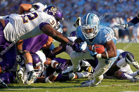 Giovani Bernard, Michael Brooks North Carolina's Giovani Bernard (26) scores a touchdown as East Carolina's Michael Brooks (92) defends during the second half of an NCAA college football game in Chapel Hill, N.C., . North Carolina won 27-6