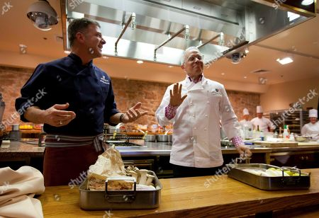 Michael Chirello, Geoffrey Zakarian Chefs Michael Chiarello, left, and Geoffrey Zakarian, right, of New York City, joke with each other after seeing the ingredients they will cook with during a Food Fight event between the two at Flavor! Napa Valley at the Culinary Institute of America at Greystone in St. Helena, Calif. Flavor! Napa Valley is a five-day food and wine festival which runs through Sunday