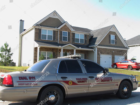 Slug Georgia-LA Teen Abuse A Paulding County sheriff's deputy sits, outside the suburban home in Dallas, Ga., about 30 miles outside Atlanta, where authorities say Paul and Sheila Comer kept their 18-year-old son in a bedroom for about two years before the emaciated teenager was placed on a bus to Los Angeles by his stepfather. Los Angeles police said the teen told officers his stepfather gave him $200 and a list of homeless shelters before he was put on a bus to California on his 18th birthday. The couple faced charges of false imprisonment and cruelty to children, Paulding County jail records show. (AP Photo/Russ Bynum