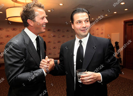 Eddie Olczyk, Mike Modano Hockey greats Eddie Olczyk, right, and Mike Modano shake hands and visit before the U.S. Hockey Hall of Fame class of 2012 induction dinner in Dallas