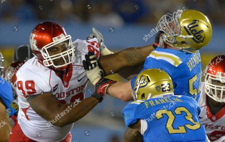 Dominic Miller, Jake Brendel Houston defensive lineman Dominic Miller, left, and UCLA center Jake Brendel battle during the second half of their NCAA college football game, in Pasadena, Calif