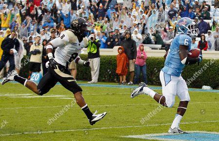 Sean Tapley, Gary Walker North Carolina's Sean Tapley (6) scores a touchdown as Idaho's Gary Walker (8) trails during the first half of an NCAA college football game in Chapel Hill, N.C