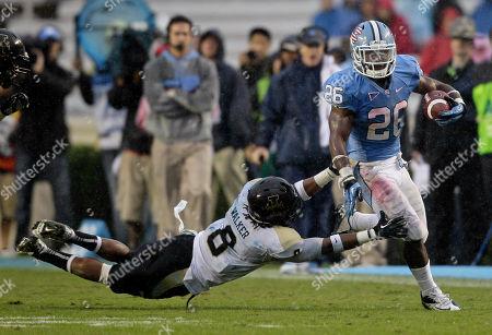 Gary Walker, Giovani Bernard North Carolina's Giovani Bernard (26) breaks a tackle against Idaho's Gary Walker (8) during the first half of an NCAA college football game in Chapel Hill, N.C