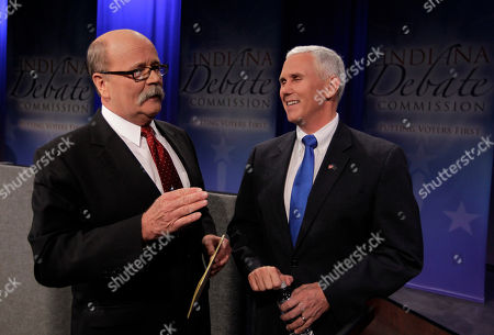 Mike Pence, John Gregg Candidates for Indiana governor, Democrat John Gregg, left, and Republican Mike Pence chat following a debate in Fort Wayne, Ind., . Libertarian Rupert Boneham also participarted
