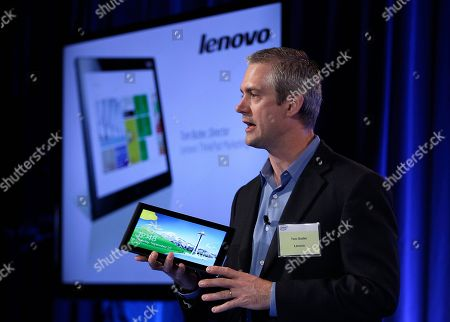 Tom Butler Tom Butler, Director of Lenovo ThinkPad Marketing, speaks while holding a Lenovo tablet, in San Francisco. Intel previewed a wave of tablet computers powered by a microprocessor that the company redesigned to make a bigger dent in the rapidly growing mobile market. An assortment of major computer vendor made the tablets previewed Thursday in San Francisco. All the devices depend on Intel Corp.'s new processor and Windows 8, a dramatic overhaul of the widely used operating system made by Microsoft Corp