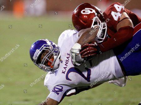 James Sims, Jayday Bird Kansas' James Sims (29) is tackled by Oklahoma linebacker Jaydan Bird in the fourth quarter of an NCAA college football game in Norman, Okla., . Oklahoma won 52-7