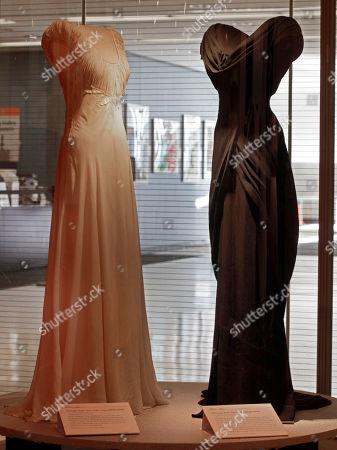"""A design by Irene, left, from the 1948 MGM movie """"State of the Union,"""" and one by Walter Plunkett from the 1949 MGM movie """"Adam's Rib,"""" are shown as part of the """"Katharine Hepburn: Dressed for Stage and Screen"""" exhibit in the New York Public Library for the Performing Arts at Lincoln Center"""