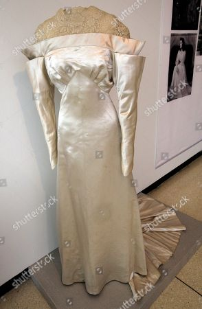 """A white satin and lace wedding dress by Howard Greer, from the 1934 production of """"The Lake,"""" is shown as part of the """"Katharine Hepburn: Dressed for Stage and Screen"""" exhibit in the New York Public Library for the Performing Arts at Lincoln Center"""