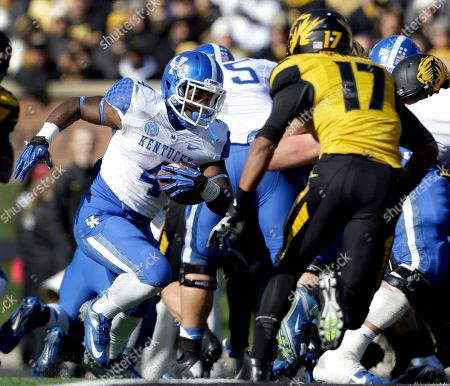 Raymond Sanders, Matt White Kentucky running back Raymond Sanders, left, runs into the end zone past Missouri safety Matt White, right, for a touchdown during the first half of an NCAA college football game, in Columbia, Mo