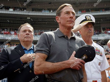 """David Petraeus, James A. """"Sandy"""" Winnefeld CIA Director David Petraeus, center, stands with Admiral James A. """"Sandy"""" Winnefeld, Vice Chairman of the Joint Chiefs of Staff, right, before a baseball game between the Washington Nationals and the Miami Marlins at Nationals Park, in Washington"""