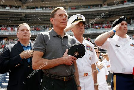 """David Petraeus, James A. """"Sandy"""" Winnefeld CIA Director David Petraeus, second from left, stands with Admiral James A. """"Sandy"""" Winnefeld, Vice Chairman of the Joint Chiefs of Staff, second from right, before a baseball game between the Washington Nationals and the Miami Marlins at Nationals Park, in Washington"""