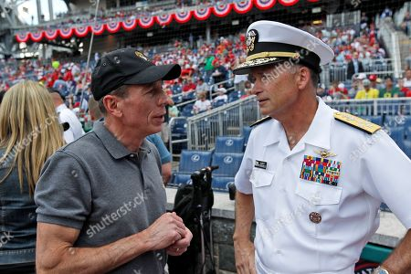 """David Petraeus, James A. """"Sandy"""" Winnefeld CIA Director David Petraeus, left, talks with Admiral James A. """"Sandy"""" Winnefeld, Vice Chairman of the Joint Chiefs of Staff, before a baseball game between the Washington Nationals and the Miami Marlins at Nationals Park, in Washington"""