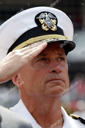 """James A. """"Sandy"""" Winnefeld Admiral James A. """"Sandy"""" Winnefeld, Vice Chairman of the Joint Chiefs of Staff, salutes during the National Anthem before a baseball game between the Miami Marlins and the Washington Nationals at Nationals Park, in Washington"""