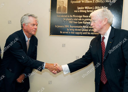 """Billy McCoy, Dick Hall Former Speaker of the Mississippi House of Representatives William """"Billy"""" McCoy of Rienzi, left, shakes hands with Transportation Commissioner for the Central District Dick Hall, after unveiling the plaque in the background noting the dedication of the Mississippi Department of Transportation headquarters in downtown Jackson, Miss., as the William J. """"Billy"""" McCoy Building, . The Democrat McCoy served in the House from January 1980 until January 2012 and was the chamber's presiding officer for the final eight years of his career. He was instrumental in passing a major highway program in 1987"""