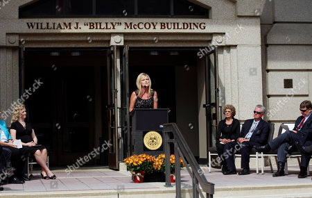 """Stock Image of Billy McCoy, Kim McCoy Eubank Former Speaker of the Mississippi House of Representatives William """"Billy"""" McCoy of Rienzi, second from right, listens to his daughter Kim McCoy Eubank, at podium, speak on behalf of the family during the dedication of the Mississippi Department of Transportation headquarters in downtown Jackson, Miss., as the William J. """"Billy"""" McCoy Building, . The Democrat McCoy served in the House from January 1980 until January 2012 and was the chamber's presiding officer for the final eight years of his career. He was instrumental in passing a major highway program in 1987"""