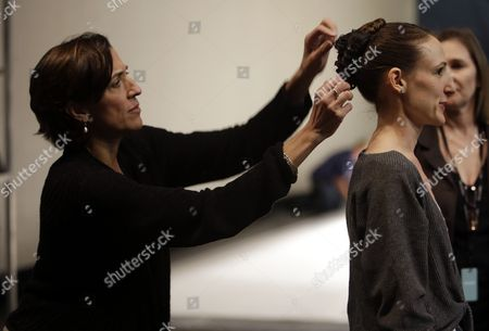 Stock Photo of Lourdes Lopez Lourdes Lopez, the new artistic director for the Miami City Ballet, left, adjusts a dancer's hair backstage before a rehearsal for the Miami City Ballet, in Miami. Their season begins Friday