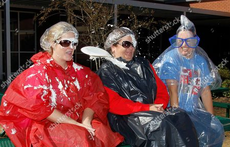 Stonebridge Elementary School Principal Sue Townsend, center and assistant principals Karen Schmidt, left, and Amanda Stocks are pelted with whipped cream pies by a delegation of students that were the top fund raisers for their technology fund drive, in Brandon, Miss., . The student body raised $8,500 that will be used to purchase more IPads and laptops for the students to use. The top fund raisers from each class got an opportunity to toss the whipped cream pie at any or all of the three administrators