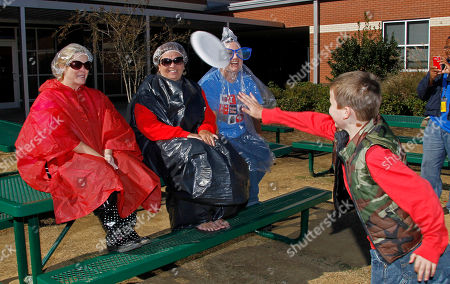 Sue Townsend, Karen Schmidt, Amanda Stocks, Owen Wolf Stonebridge Elementary School Principal Sue Townsend, center and her two assistant principals, Karen Schmidt, left, and Amanda Stocks, steel themselves for the first cream pies tossed at them by Owen Wolf, 9, a third grade student, on the Brandon, Miss., campus. The top fund raising students of a recent technology fund drive and two teachers got the opportunity to toss a pie at the administrators. The student body raised $8,500 that will be used to purchase more IPads and laptops for the students to use