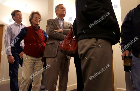 Stock Photo of Todd Akin Missouri U.S. Senate candidate, Rep. Todd Akin, R-Mo., center, waits in line to vote along with his wife Lulli, center left, and son Wynn, left, at their polling place, Star Bridge Christian Center, in Wildwood, Mo. Akin is running against incumbent Sen. Claire McCaskill, D-Mo