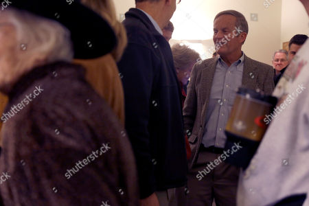 Stock Picture of Todd Akin Missouri Senate candidate, Rep. Todd Akin, R-Mo., chats with other voters in line as they wait to cast their ballots at Star Bridge Christian Center, in Wildwood, Mo. Akin is running against incumbent Sen. Claire McCaskill, D-Mo