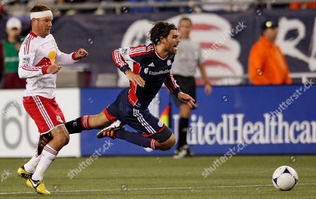 Juan Toja, Rafa Marquez New England Revolution midfielder Juan Toja, right, sails through the air as his leg gets tangled with New York Red Bulls midfielder Rafa Marquez's (4) during their MLS soccer match in Foxborough, Mass., . The Red Bulls and Revolution tied 1-1