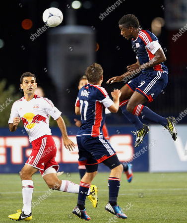 Clyde Simms, Kelyn Rowe, Rafa Marquez New England Revolution midfielder Clyde Simms, right, heads the ball over midfielder Kelyn Rowe (11) and New York Red Bulls midfielder Rafa Marquez (4) during their MLS soccer match in Foxborough, Mass