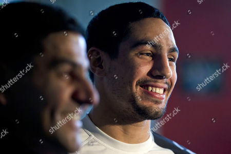 Danny Garcia Boxer Danny Garcia, right, accompanied by his father and trainer Angel Garcia, speaks with reporters after a workout in Philadelphia. Garcia is slated to defend his WBC and WBA junior welterweight titles against Erik Morales at the first boxing event at Brooklyn's new Barclays Center arena on Saturday, Oct. 20