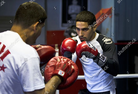 Danny Garcia Boxer Danny Garcia, right, works out with his father and trainer Angel Garcia in Philadelphia. Garcia is slated to defend his WBC and WBA junior welterweight titles against Erik Morales at the first boxing event at Brooklyn's new Barclays Center arena on Saturday, Oct. 20
