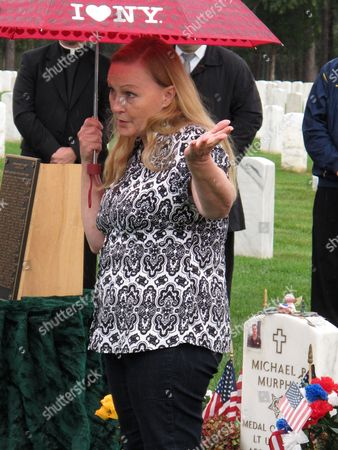 Stock Picture of Maureen Murphy, the mother of Navy SEAL Lt. Michael Murphy, speaks during a memorial service for her son at Calverton National Cemetery in Calverton, N.Y., on . Maureen Murphy will participate in a commissioning ceremony for the USS Michael Murphy in New York City on Saturday, Oct. 6. Lt. Murphy received the Medal of Honor after being killed while fighting in Afghanistan in 2005