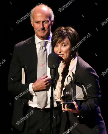 Pam TIllis, Martino Coppo Country music star Pam Tillis and Italian bluegrass musician Martino Coppo, left, accept the guitar player of the year award on behalf of the late Doc Watson at the International Bluegrass Music Association Awards show, in Nashville, Tenn