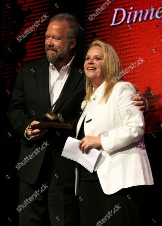 Don Schlitz, Mary Chapin Carpenter Mary Chapin Carpenter is presented with her trophy by fellow songwriter Don Schlitz, left, as Carpenter is inducted into the Nashville Songwriters Hall of Fame, in Nashville, Tenn