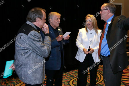 Kim Williams, Larry Henley, Mary Chapin Carpenter, Tony Arata Kim Williams, left; Larry Henley, second from left; Mary Chapin Carpenter, second from right; and Tony Arata, right; talk before they are inducted into the Nashville Songwriters Hall of Fame, in Nashville, Tenn