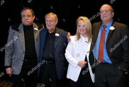 Kim Williams, Larry Henley, Mary Chapin Carpenter, Tony Arata Kim Williams, left; Larry Henley, second from left; Mary Chapin Carpenter, second from right; and Tony Arata, right; pose together before they are inducted into the Nashville Songwriters Hall of Fame, in Nashville, Tenn