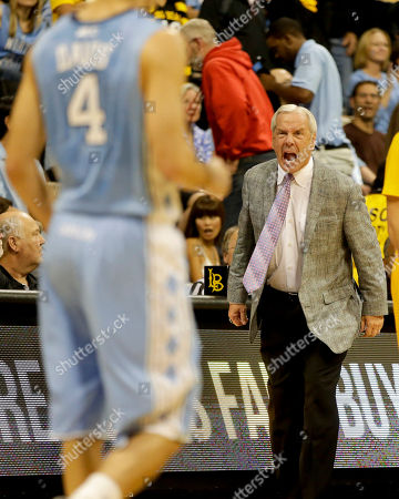North Carolina coach Roy Williams yells to Luke Davis during the second half of an NCAA basketball game against the Long Beach State in Long Beach, Calif