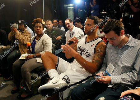Deron Williams Brooklyn Nets Deron Williams asks a question of coach Avery Johnson during team media day, in the Brooklyn borough of New York