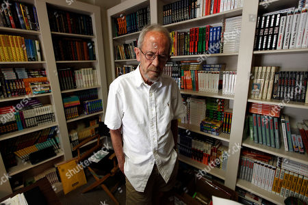 Stock Photo of Elmore Leonard Author Elmore Leonard, 86, stands in his Bloomfield Township, Mich., home. Leonard, a former adman who later in life became one of America's foremost crime writers, has died. He was 87. His researcher says he passed away Tuesday morning, Aug. 20, 2013 from complications from a stroke