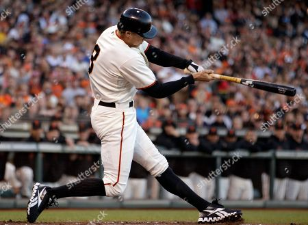 Hunter Pence San Francisco Giants' Hunter Pence swings for an RBI sacrifice fly off San Diego Padres' Andrew Werner in the first inning of a baseball game, in San Francisco