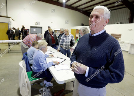 Mike Pence Indiana's Republican gubernatorial candidate Mike Pence speaks to the media before he casts his vote, in Clifford, Ind. Pence is running against Democrat John Gregg and Libertarian Rupert Boneham