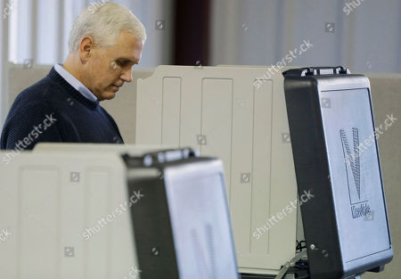 Mike Pence Indiana's Republican gubernatorial candidate Mike Pence casts his vote, in Clifford, Ind. Pence is running against Democrat John Gregg and Libertarian Rupert Boneham