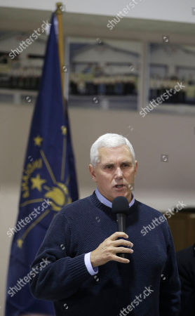 Stock Photo of Mike Pence Indiana's Republican gubernatorial candidate Mike Pence talks to supporters before voting, in Clifford, Ind. Pence is running against Democrat John Gregg and Libertarian Rupert Boneham