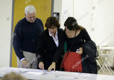 Mike Pence, Karen Pencem Audrey Pence Indiana Republican candidate for governor Mike Pence, left, with his wife, Karen, and daughter, Audrey, look at a sample ballot before voting, in Clifford, Ind. Pence is running against Democrat John Gregg and Libertarian Rupert Boneham